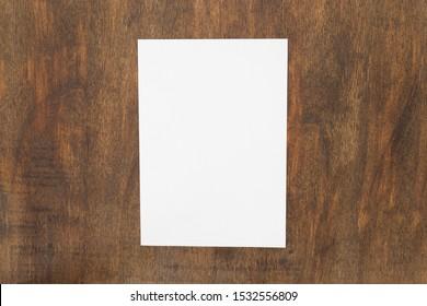Blank paper sheets for brochure on wooden background. Mock up.