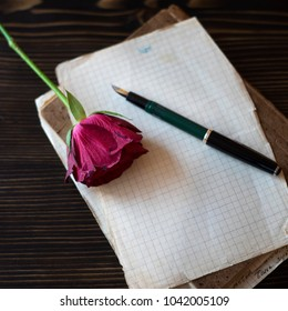 Blank paper sheets on old wooden table, love story