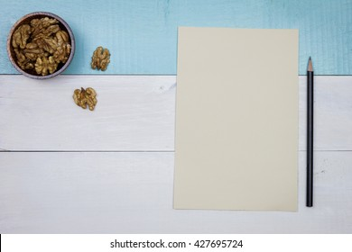 Blank paper with snack, walnuts