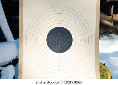 Blank paper target with shooting range numbers. A round, clean target with a marked bull's-eye for shooting practice on the range
