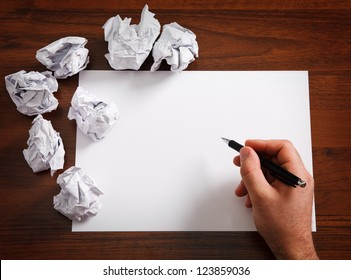 Blank paper waiting for idea with mans  hand and  pen