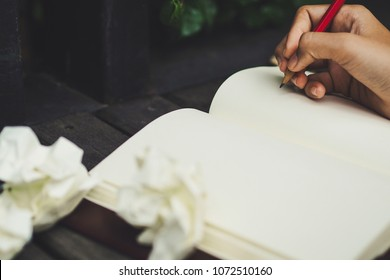 Blank paper waiting for idea with woman hand and pencil