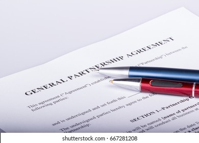 Blank Partnership contract with two pens on top of the first page