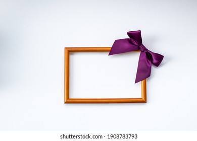 blank photo frame with bow