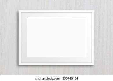 Blank photo frame mockup on textured wallpaper