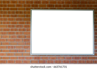 Blank photo frame on red brick wall.