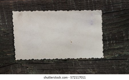 Blank photo frame on a vintage wooden background