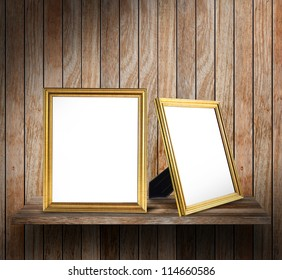 Blank Photo frame on wood shelf