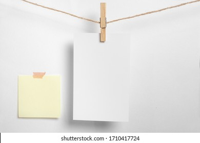 Blank photo frame with soft shadows and scotch tape isolated on white paper background as template for graphic designers presentations, portfolios etc.