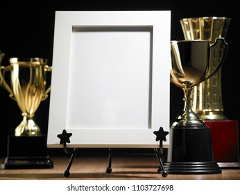 blank photo frame and trophy