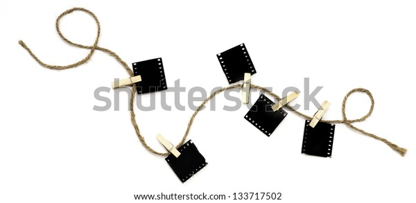 Blank photo frames with hanger on rope lay on white background