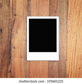 blank photo frames on brown wood texture background