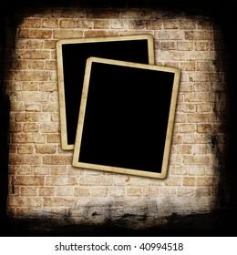 Blank photo frames on grunge wall