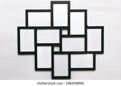 Blank photo picture frame isolated on white wooden board background.