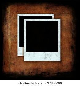 Blank photographs on grunge wall texture