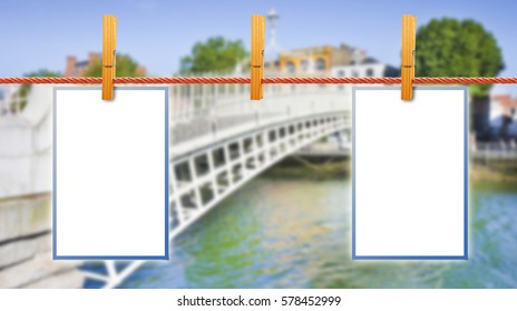 Blank photos hanging on clothesline with Half Penny Bridge on background (Dublin - Ireland)