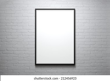 Blank picture frame at the brick wall with copy space and clipping path for the inside