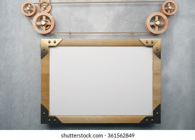 Blank picture frame in the style of steampunk hanging on concrete wall, mock up