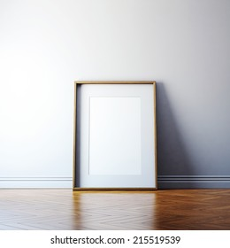 Blank picture frame and sunlight on a wall