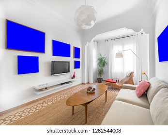 Blank picture template in a cozy stylish bright living room with natural ratan carpet, sofa, wooden table, plants and gallery on wall. Spacious modern interior in earthy colors with frame mockup