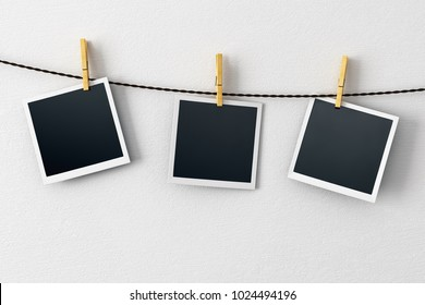 Blank pictures hanging on concrete wall background. Photography and art concept. Mock up, 3D Rendering