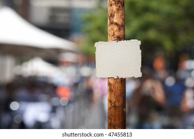 Blank piece of cardboard nailed on electric wooden pole