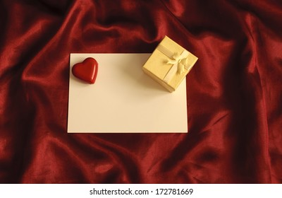 Blank piece of paper and a small jewelry gift box