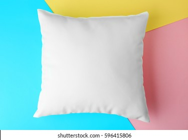 Blank pillow on color paper background