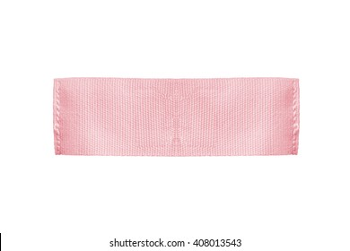 Blank pink textile clothes label on white background