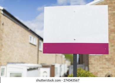 Blank placard sign outside a row of terraced houses