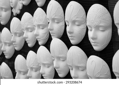Blank plaster faces templates for future painted masks. Black and white photo.