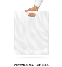 Blank plastic bag mock up holding in hand. Empty polyethylene package mockup hold in hands isolated on white. Consumer pack ready for logo design or identity presentation. Product food packet handle.
