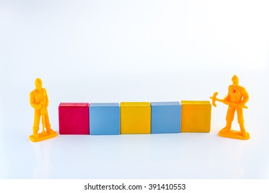blank plastic block with workmen figure o white background