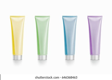 Blank plastic tubes of pastel colors on a white background