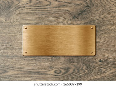 Blank polierter, goldener Namensschild auf Holzhintergrund für Text, Namen oder Logos