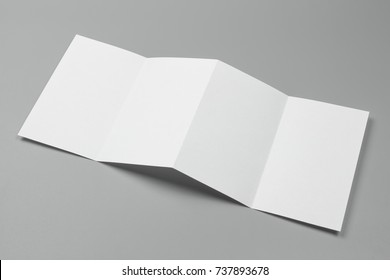Blank portrait A4. changeable background / white paper isolated on gray. identity design, corporate templates, company style, set of booklets, blank white folding paper flyer