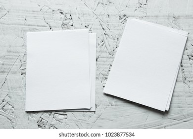 Blank portrait mock-up paper. brochure magazine isolated on white wood, changeable background / white paper isolated on table