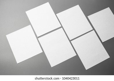 Blank portrait mock-up paper. brochure magazine isolated on gray, changeable background / white paper isolated on gray.