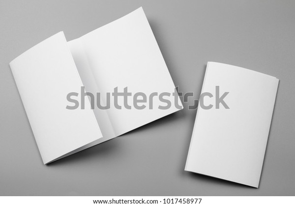 Blank portrait mock-up paper. brochure magazine isolated on gray, changeable background / white paper isolated on gray