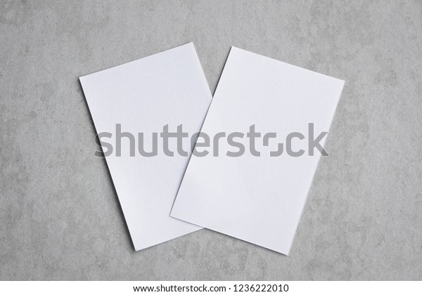 Blank portrait mock-up paper. brochure magazine isolated on gray, changeable background / white paper isolated on gray cement backdrop.