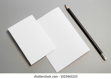 Blank portrait mock-up paper with pencil. brochure magazine isolated on gray, changeable background / white paper isolated on gray