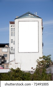 Blank portrait oriented panel on a building, ready to put your graphics on