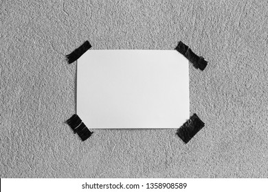 Blank portrait paper. brochure on gray cement wall, changeable background. white paper note on gray