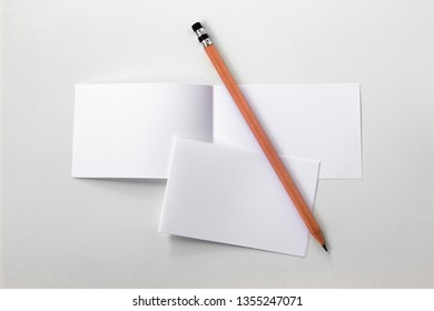 Blank portrait white paper with pencil. brochure magazine isolated on gray, changeable background / white paper isolated on gray