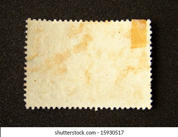 Blank postage stamp on black background.