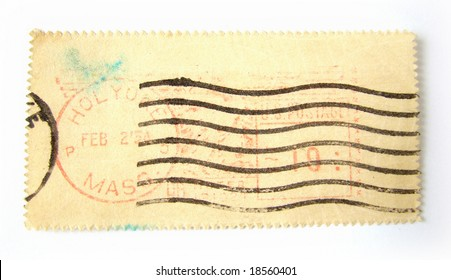 Blank postage stamp with postmarks on white background