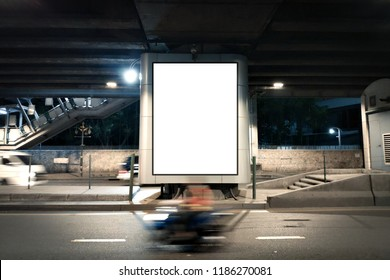 Blank Poster display advertisement on street.Empty poster under Overpass and Night light traffic.