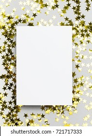 Blank poster invite against a gold star confetti backround