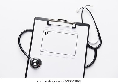 Blank prescription pad, with stethoscope and clipboard.