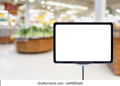 Blank price board with fresh food in supermarket abstract blurred background with bokeh light